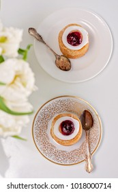 This is for you, coffee table for 2. Runeberg's tart or cake is a Finnish traditional dessert and pastry, tulips on a foreground.