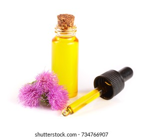 thistle oil and milk thistle flower isolated on white background