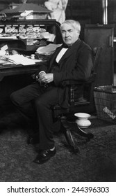 Thomas A. Edison (1847-1931) at his desk in his West Orange, New Jersey, laboratory, ca. 1913.