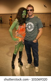"""Thomas Jane with Alicia Arden from CelebrityCosplay.com as the """"Orion Slave Girl"""" from Star Trek at Long Beach Comic-Con Day 2, Long Beach Convention Center, Long Beach, CA. 10-30-10"""