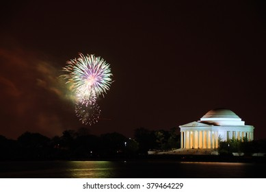 Thomas Jefferson Memorial illuminated with light and fireworks in cherry blossom festival. Washington DC.