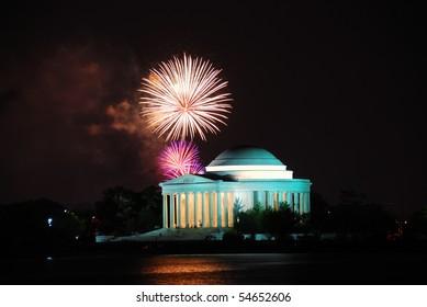 Thomas Jefferson Memorial illuminated with light and fireworks. Washington DC.