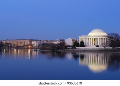 Thomas Jefferson Memorial at night with mirror reflection on water, Washington DC United States