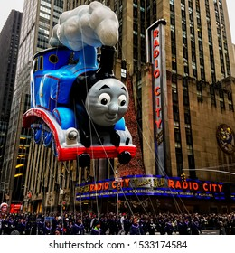 The Thomas The Tank Engine floats in the air during Macy's Thanksgiving Day parade along Avenue of Americas with the Radio Music Hall in the background. Manhattan, New York, USA November 27, 2014.
