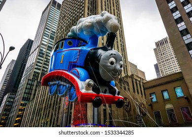 Thomas The Tank Engine floats in the air during Macy's Thanksgiving Day parade along Avenue of Americas with the Radio Music Hall in the background. Manhattan, New York, USA November 27, 2014.
