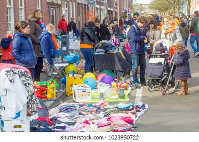 Thomsonlaan, The Hague, the Netherlands -27 April 2017: People buying and selling household objects street flea market on Kingsday