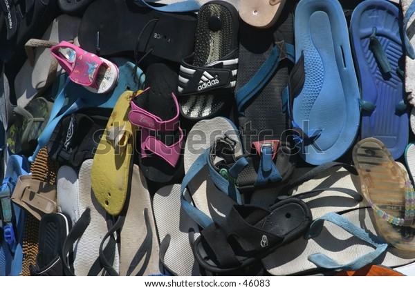 """Thong Totems"" - Beach goer wear thong to the beach"