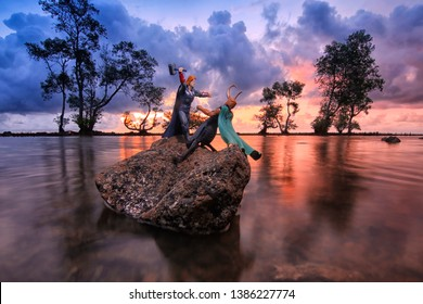 Thor was fighting with Loki on a beach in Anyer, Banten, Indonesia, on March 12, 2016.