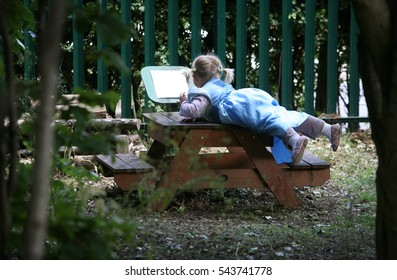THORNABY, TEESSIDE/UK - JUNE 7th 2011 - A toddler playing in the grounds of a nursery school.