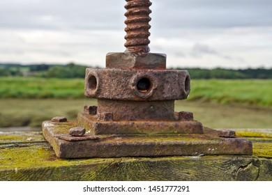 Thornham, Norfolk, England, Britain, July 2019, rust covered metal control of sluice gate on salt marsh
