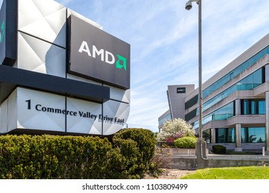 Thornhill, Ontario, Canada - May 21, 2018: Sign and office building of AMD in Thornhill, Ontario.  Advanced Micro Devices, Inc. (AMD) is an American multinational semiconductor company.
