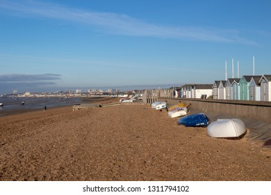 Thorpe Bay, Essex / England - 11/02/2019: Boats and beach huts on the beach