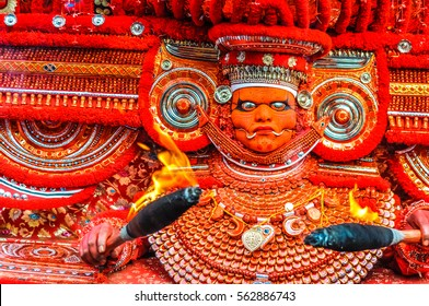 Thottada, south of Kannur, Kerala - circa January 2012: Huge artistic mask and costume of performer at Theyyam festival near Thottada, south of Kannur, Kerala. Documentary editorial.