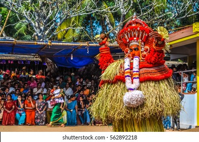 Thottada, south of Kannur, Kerala - circa January 2012: Dancer in costume made of straw during Theyyam near Thottada, south of Kannur, Kerala. Documentary editorial.