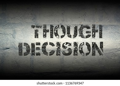 though decision stencil print on the grunge white brick wall