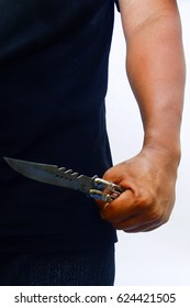 though hand holding knife over white background