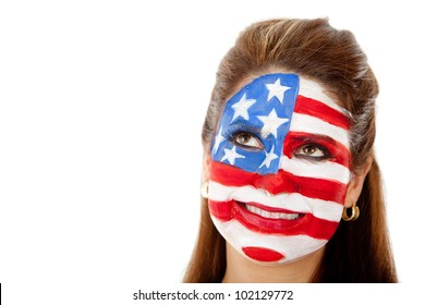 Thoughtful American woman with the USA flag painted on her face ���� isolated
