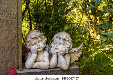 Thoughtful angel couple figures on a Stone wall