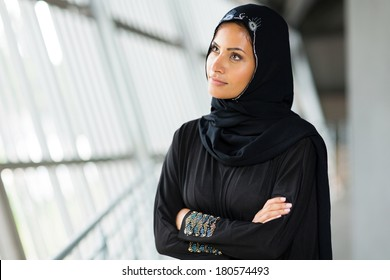 thoughtful arabian woman with arms crossed