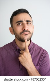 Thoughtful Attractive Man Touching Chin
