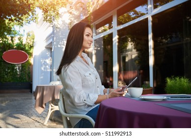 thoughtful attractive woman thinking about something, pensive female breakfast in coffee shop,