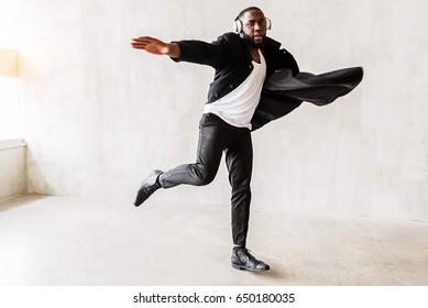 Thoughtful bearded guy wearing black-and-white stylish clothing