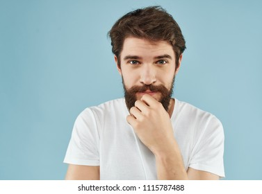 thoughtful bearded man looks at the camera