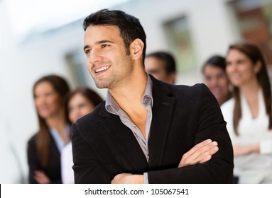 Thoughtful business man leading a corporate group