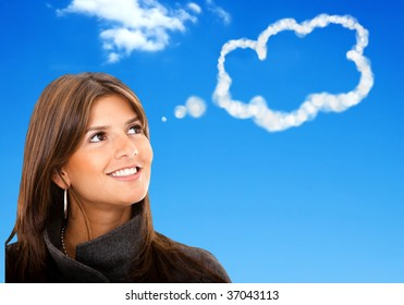 Thoughtful business woman with a blue sky on the background