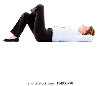 Thoughtful business woman lying down - isolated over white background