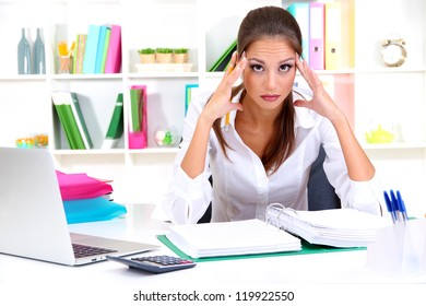 Thoughtful business woman with notebook in office