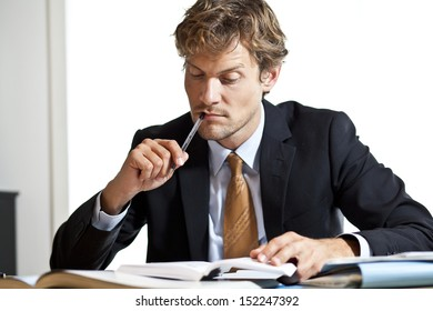 Thoughtful businessman getting ideas looking at his papers