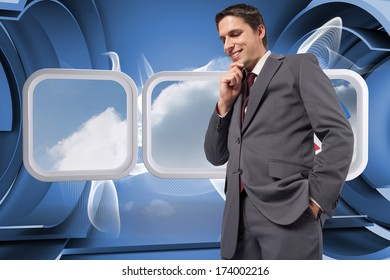 Thoughtful businessman with hand on chin against abstract linear design in blue and white
