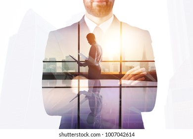 Thoughtful businessman on abstract city background with copy space. Success and executive concept. Double exposure