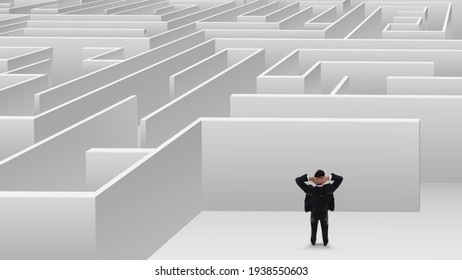 Thoughtful businessman trying to find way out of maze