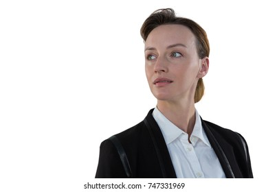 Thoughtful businesswoman smiling against white background