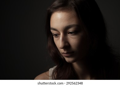 Thoughtful calm woman in low key. Depression