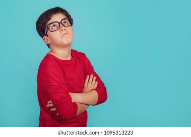 thoughtful child on blue background