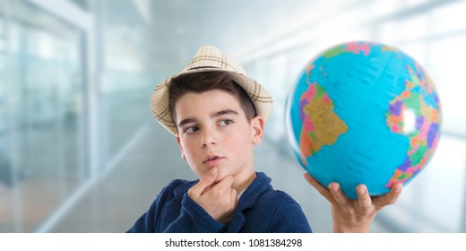 thoughtful and creative student with the world map