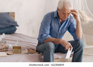 Thoughtful depressed man being involved in his memories