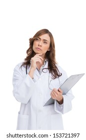 Thoughtful doctor looking away against white background