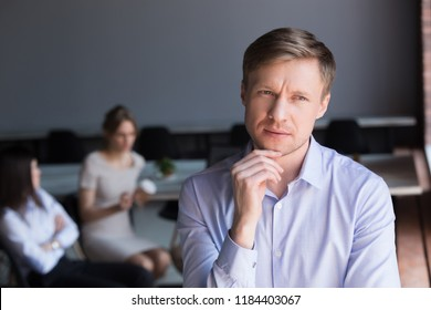 Thoughtful doubtful middle aged businessman looking away thinking about challenge, solving problem, serious ceo uncertain about difficult question searching new ideas at work, business doubt concept