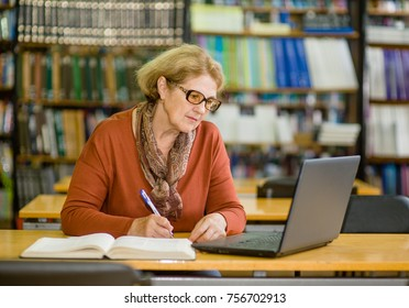 Thoughtful elderly woman in library