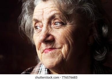 Thoughtful elderly woman portrait