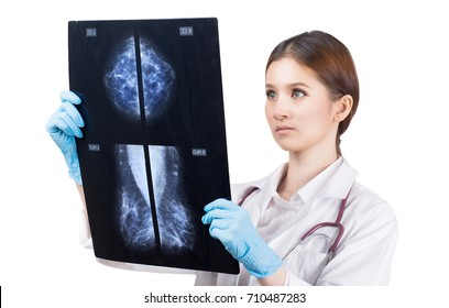 Thoughtful female doctor looking at the Mammogram film image isolate on a white background.