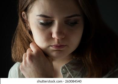 thoughtful girl in a dark key
