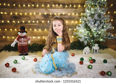 thoughtful girl in oriental suit at christmas tree