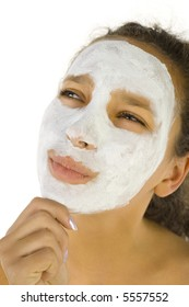 Thoughtful girl with purifying mask on face. She's on white background