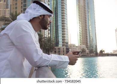 Thoughtful guy standing looking at city , considering new opportunity, thinking over future