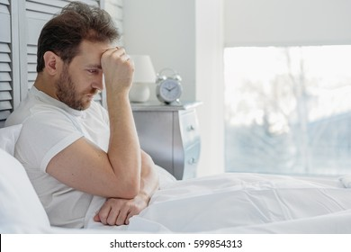 Thoughtful guy suffers from insomnia